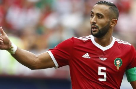 Morocco's Mehdi Benatia gestures during the group B match between Portugal and Morocco at the 2018 soccer World Cup in the Luzhniki Stadium in Moscow, Russia, Wednesday, June 20, 2018. (AP Photo/Matthias Schrader)