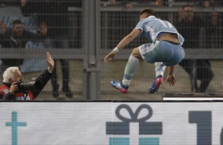 Lazio's Ciro Immobile celebrates after scoring during an Italian Cup, first-leg, semifinal soccer match between Lazio and Roma, at the Rome Olympic stadium, Wednesday, March 1, 2017. (AP Photo/Gregorio Borgia)