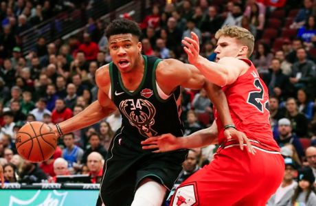 epa07363296 Milwaukee Bucks forward Giannis Antetokounmpo of Greece (L) drives around Chicago Bulls forward Lauri Markkanen of Finland (R) during the NBA game between the Milwaukee Bucks and the Chicago Bulls at the United Center in Chicago, Illinois, USA, 11 February 2019.  EPA/TANNEN MAURY SHUTTERSTOCK OUT