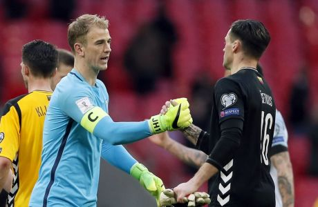 England's goalkeeper Joe Hart, front left, and Lithuania's goalkeeper Ernestas Setkus, front right, shake hands after the World Cup Group F qualifying soccer match between England and Lithuania at the Wembley Stadium in London, Great Britain, Sunday, March 26, 2017. England defeated Lithuania by 2-0. (AP Photo/Kirsty Wigglesworth)
