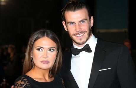 Gareth Bale, right, and Emma Rhys-Jones pose for photographers on arrival for the World Premiere of the latest Bond film, Spectre, at the Royal Albert Halll in central London, Monday, Oct. 26, 2015. (Photo by Joel Ryan/Invision/AP)
