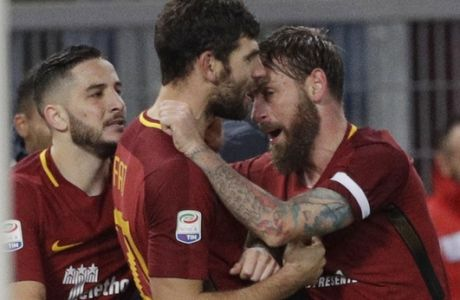 Roma's Federico Fazio, center, celebrates with teammates Daniele De Rossi, right, and Kostas Manolas during an Italian Serie A soccer match between AS Roma and Cagliari, at the Olympic stadium in Rome, Saturday, Dec. 16, 2017. (AP Photo/Gregorio Borgia)