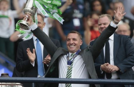Celtic manager Brendan Rodgers lifts the Scottish Cup after victory against Motherwell in the William Hill Scottish Cup Final at Hampden Park, Glasgow, Saturday May 19, 2018. (Graham Stuart/PA via AP)
