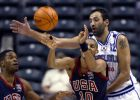 Reggie Miller, front, of the United States makes a pass under pressure from Vlade Divac of Yugoslavia as Antonio Davis, left, looks on in the second quarter of the quarterfinals of the World Basketball Championships in Indianapolis, Thursday, Sept. 5, 2002. (AP Photo/Michael Conroy)
