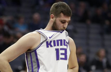 Sacramento Kings center Georgios Papagiannis, of Greece, holds his jersey in his mouth during the closing moments of the Kings' 131-111 loss to the Charlotte Hornets in an NBA basketball game Tuesday, Jan. 2, 2018, in Sacramento, Calif. (AP Photo/Rich Pedroncelli)