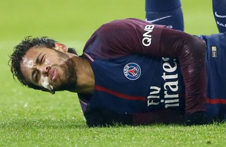 PSG's Neymar reacts after falling during their French League One soccer match between Paris Saint Germain and Caen, at the Parc des Princes stadium in Paris, France, Wednesday, Dec. 20, 2017. (AP Photo/Francois Mori)