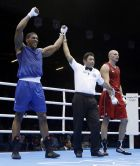 Britain's Anthony Joshua reacts after beating Kazakhstan's Ivan Dychko in a super heavyweight over 91-kg semifinal boxing match at the 2012 Summer Olympics, Friday, Aug. 10, 2012, in London. (AP Photo/Patrick Semansky)