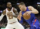Los Angeles Clippers' Blake Griffin, right, drives against Cleveland Cavaliers' LeBron James during the second half of an NBA basketball game, Friday, Nov. 17, 2017, in Cleveland. The Cavaliers won 118-113 in overtime. (AP Photo/Tony Dejak)