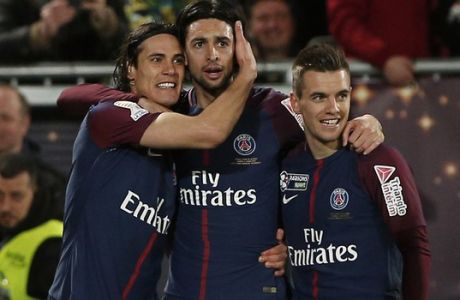 PSG's Edison Cavani, left, celebrates with teammates Lucas, center, and Giovani Lo Celso, right, after scoring his side third goal during the League Cup final soccer match between Paris Saint Germain and Monaco in Bordeaux, southwestern France, Saturday, March 31, 2018. (AP Photo/Thibault Camus)