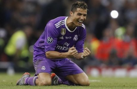 Real Madrid's Cristiano Ronaldo celebrates at the end of the Champions League final soccer match between Juventus and Real Madrid at the Millennium Stadium in Cardiff, Wales, Saturday June 3, 2017. Real Madrid won 4-1. (AP Photo/Kirsty Wigglesworth)
