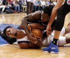 Dallas Mavericks guard Dennis Smith Jr. (1) fights for the ball with Los Angeles Clippers guard Patrick Beverley (21) during the second half of an NBA basketball game in Dallas, Sunday, Dec. 2, 2018. Smith Jr. lost a tooth on the play. Dallas won 114-110. (AP Photo/Michael Ainsworth)