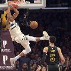 Milwaukee Bucks Giannis Antetokounmpo (34) dunks over Los Angeles Lakers forward Josh Hart (5) during the fourth quarter of an NBA basketball game in Los Angeles Friday, March 30, 2018. The Bucks won in overtime 124-122. (AP Photo/Reed Saxon)