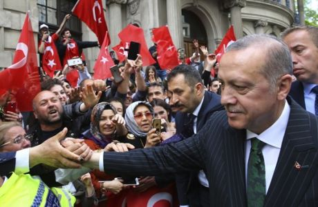 "Turkey's President Recep Tayyip Erdogan shakes hands as his supporters gathered outside his hotel in London, Sunday, May 13, 2018. Erdogan started a three-day visit to Britain by praising the country as ""an ally and a strategic partner, but also a real friend."" (Presidential Press Service/Pool via AP)"