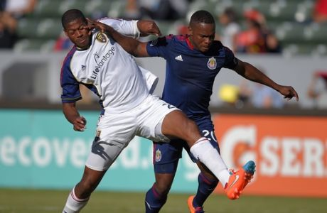 Real Salt Lake defender Chris Schuler, left, and Chivas USA forward Felix Borja battle for the ball during the first half of a Major League Soccer match, Sunday, Oct. 5, 2014, in Carson, Calif. (AP Photo/Mark J. Terrill)