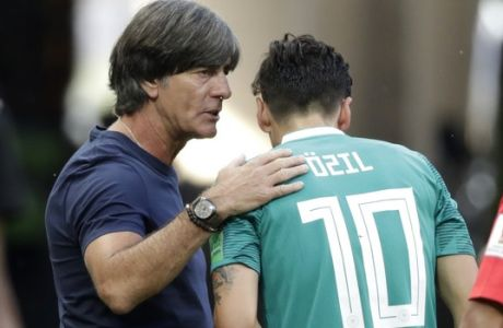 Germany head coach Joachim Loew, left, talks to Germany's Mesut Ozil, right, during the group F match between South Korea and Germany, at the 2018 soccer World Cup in the Kazan Arena in Kazan, Russia, Wednesday, June 27, 2018. (AP Photo/Lee Jin-man)