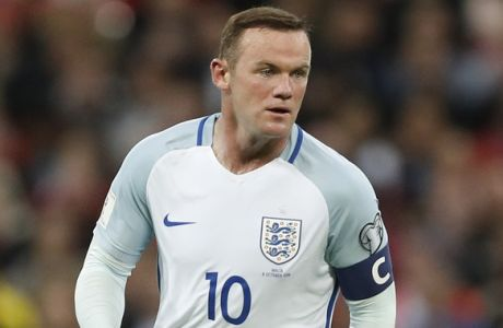 Englands Wayne Rooney controls the ball during the World Cup Group F qualifying soccer match between England and Malta at Wembley stadium in London, Saturday, Oct. 8, 2016. (AP Photo/Kirsty Wigglesworth)