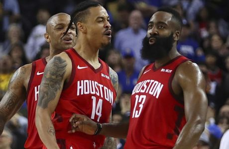 Houston Rockets' James Harden, right, celebrates with Gerald Green (14) and PJ Tucker, left, after making the game winning basket against the Golden State Warriors during overtime of an NBA basketball game Thursday, Jan. 3, 2019, in Oakland, Calif. (AP Photo/Ben Margot)