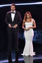 Co-host and US actress Eva Longoria (R) speaks on stage next to co-host Marco Schreyl during The Best FIFA Football Awards ceremony, on January 9, 2017 in Zurich. / AFP PHOTO / Fabrice COFFRINI