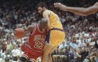 Chicago Bulls' Michael Jordan drives through Los Angeles Lakers Vlade Divac during the final moments in game five of the NBA finals at the Forum in Inglewood, Calif., Wednesday, June 13, 1991. The Bulls won 108-101 taking the NBA championship. (AP Photo/Bob Galbraith)