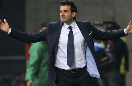 FILE- In this Tuesday, April 28, 2015 file photo, the then Udinese coach Andrea Stramaccioni open his arms during a Serie A soccer match between Udinese and Inter Milan at the Friuli stadium in Udine, Italy. Sparta Prague said Sunday, May 28, 2017, it has signed Italian coach Andrea Stramaccioni into a two-season contract. (AP Photo/Paolo Giovannini, File)