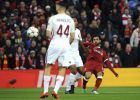 Liverpool's Mohamed Salah, right, kicks the ball during the Champions League semifinal, first leg, soccer match between Liverpool and Roma at Anfield Stadium, Liverpool, England, Tuesday, April 24, 2018. (AP Photo/Rui Vieira)