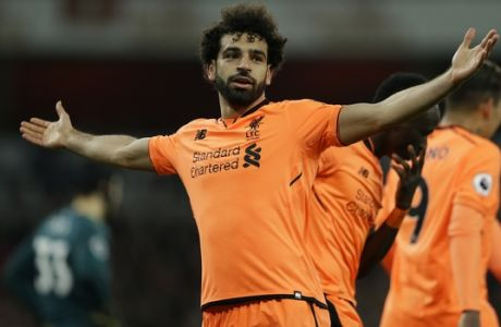 Liverpool's Mohamed Salah celebrates after he scores his sides 2nd goal of the gameduring their English Premier League soccer match between Arsenal and Liverpool at the Emirates stadium London, Friday, Dec. 22, 2017. (AP Photo/Alastair Grant)