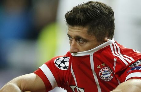 Bayern's Robert Lewandowski looks disappointed when his team failed to advance to the final during the Champions League semifinal second leg soccer match between Real Madrid and FC Bayern Munich at the Santiago Bernabeu stadium in Madrid, Spain, Tuesday, May 1, 2018. (AP Photo/Paul White)