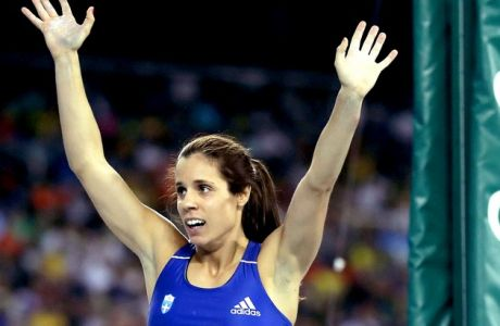 Gold medal winner, Greece's Ekaterini Stefanidi celebrates after the women's pole vault final, during the athletics competitions of the 2016 Summer Olympics at the Olympic stadium in Rio de Janeiro, Brazil, Friday, Aug. 19, 2016. (AP Photo/Matt Dunham)