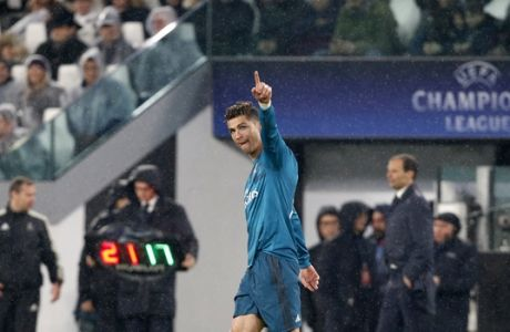 Real Madrid's Cristiano Ronaldo celebrates after scoring his side's second goal during the Champions League first leg quarter final soccer match between Juventus and Real Madrid, at Juventus Stadium in Turin, Italy, Tuesday, April 3, 2018. (AP Photo/Antonio Calanni)