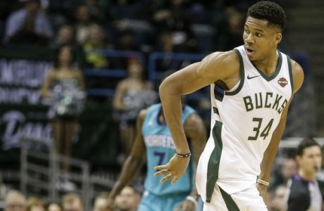Milwaukee Bucks' Giannis Antetokounmpo passes the ball behind his back against Charlotte Hornets during the first half of an NBA basketball game, Monday, Oct. 23, 2017, in Milwaukee. (AP Photo/Tom Lynn)