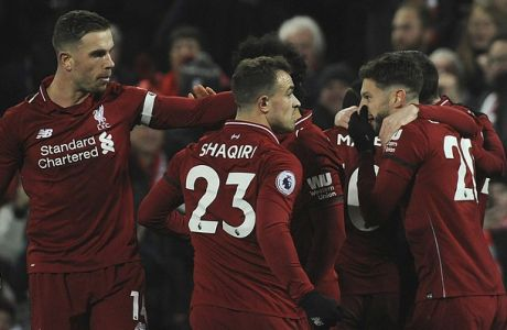 Liverpool players celebrate after Liverpool's Sadio Mane scored his side's fourth goal during the English Premier League soccer match between Liverpool and Crystal Palace at Anfield in Liverpool, England, Saturday, Jan. 19, 2019. (AP Photo/Rui Vieira)