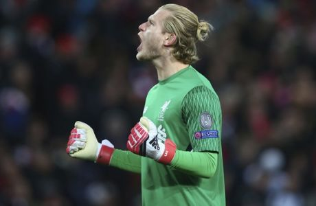 Liverpool goalkeeper Loris Karius celebrates after his team scored their first goal during the Champions League quarter final first leg soccer match between Liverpool and Manchester City at Anfield stadium in Liverpool, England, Wednesday, April 4, 2018. (AP Photo/Dave Thompson)