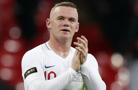 England's Wayne Rooney greets fans after his 120th cap, the international friendly soccer match between England and the United States at Wembley stadium, Thursday, Nov. 15, 2018. (AP Photo/Alastair Grant)