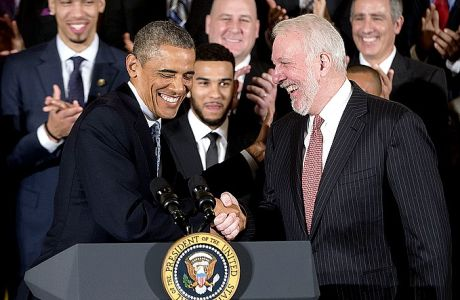 President Barack Obama shakes hands with San Antonio Spurs head basketball coach Gregg Popovich as he honored the 2014 NBA Champions the San Antonio Spurs basketball team during a ceremony in the East Room White House in Washington, Monday, Jan. 12, 2015. (AP Photo/Pablo Martinez Monsivais)