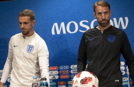 England head coach Gareth Southgate, right, and player Jordan Henderson arrive to England's official news conference on the eve of the semifinal match between England and Croatia at the 2018 soccer World Cup in Moscow, Russia, Tuesday, July 10, 2018. (AP Photo/Francisco Seco)