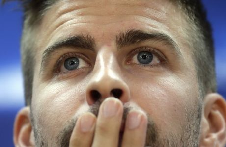 FC Barcelona's Gerard Pique gestures during a press conference at the Sports Center FC Barcelona Joan Gamper in Sant Joan Despi, Spain, Tuesday, Oct. 18, 2016. FC Barcelona will play against Manchester City in a Champions League Group C soccer match on Wednesday. (AP Photo/Manu Fernandez)