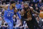 Cleveland Cavaliers forward LeBron James (23) drives past Oklahoma City Thunder forward Paul George (13) during the first half of an NBA basketball game in Oklahoma City, Tuesday, Feb. 13, 2018. (AP Photo/Sue Ogrocki)