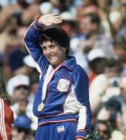 Joan Benoit, gold medalist shown waving to the fans after winning the women's marathon in the Los Angeles Coliseum on July 28, 1984. (AP Photo/Pool/Jayne Kamin)