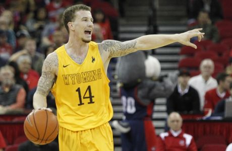 Wyoming's Josh Adams calls out a play against Fresno State in the second half of an NCAA college basketball game in Fresno, Calif., Tuesday, Jan. 26, 2016. (AP Photo/Gary Kazanjian)