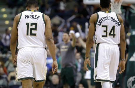 Milwaukee Bucks' Jabari Parker (12) and Giannis Antetokounmpo (34) walk onto the court during an NBA basketball game against the Brooklyn Nets Saturday, Dec. 3, 2016, in Milwaukee. (AP Photo/Aaron Gash)
