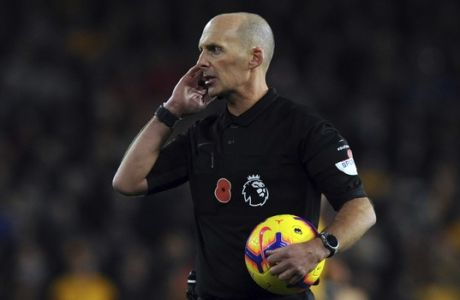 Referee Mike Dean speaks during the English Premier League soccer match between Wolverhampton Wanderers and Tottenham Hotspur at the Molineux Stadium in Wolverhampton, England, Saturday, Nov. 3, 2018. (AP Photo/Rui Vieira)