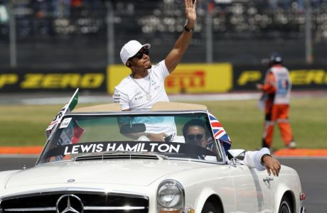 Mercedes driver Lewis Hamilton, of Britain, waves to the crowd from a classic Mercedes car before the Formula One Mexico Grand Prix auto race at the Hermanos Rodriguez racetrack in Mexico City, Sunday, Oct. 29, 2017. (AP Photo/Moises Castillo)