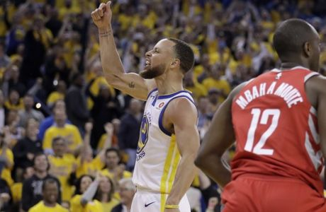 Golden State Warriors guard Stephen Curry (30) celebrates next to Houston Rockets forward Luc Mbah a Moute (12) during the second half of Game 3 of the NBA basketball Western Conference Finals in Oakland, Calif., Sunday, May 20, 2018. (AP Photo/Marcio Jose Sanchez)
