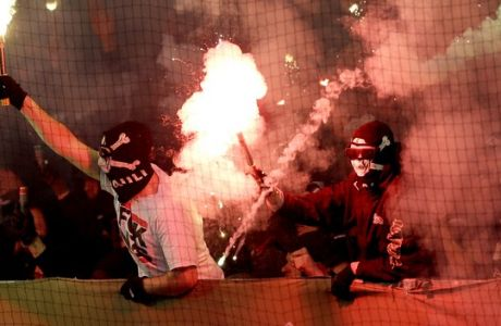 FILE - In this file photo dated Tuesday, Oct. 28, 2014, supporters of St. Pauli light fireworks during the German soccer cup second round match between FC St. Pauli and Borussia Dortmund at the Millerntor Stadium in Hamburg, Germany. (AP Photo/Michael Sohn, FILE)