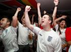 Supporters of the England football team react as England score a goal during the National Team's World Cup soccer match against Slovenia, in London, England, Wednesday June 23, 2010. (AP Photo/Tim Hales)