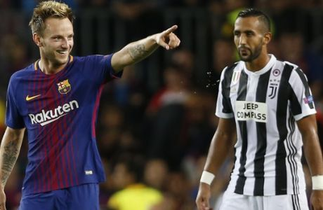 Barcelona's Ivan Rakitic, left, celebrates after scoring his side's second goal as Juventus' Medhi Benatia, right, watches during a Champions League group D soccer match between FC Barcelona and Juventus at the Camp Nou stadium in Barcelona, Spain, Tuesday, Sept. 12, 2017. (AP Photo/Francisco Seco)