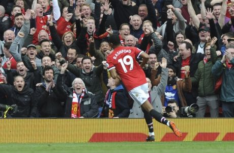 Manchester United's Marcus Rashford celebrates after scoring his sides second goal during the English Premier League soccer match between Manchester United and Liverpool at Old Trafford in Manchester, England, Saturday, March 10, 2018. (AP Photo/Rui Vieira)