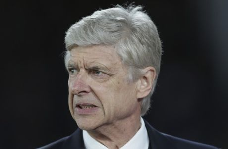 Arsenal manager Arsene Wenger looks across the pitch as he walks to the dugout ahead of the English Premier League soccer match between Crystal Palace and Arsenal at Selhurst Park in London, Monday April 10, 2017. (AP Photo/Tim Ireland)