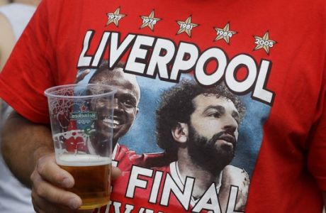Liverpool supporter gathers in Kiev, Ukraine, Friday, May 25, 2018. Supporters were gathering in Kiev ahead of the Champions League final soccer match between Real Madrid and Liverpool on Saturday May 26. (AP Photo/Efrem Lukatsky)
