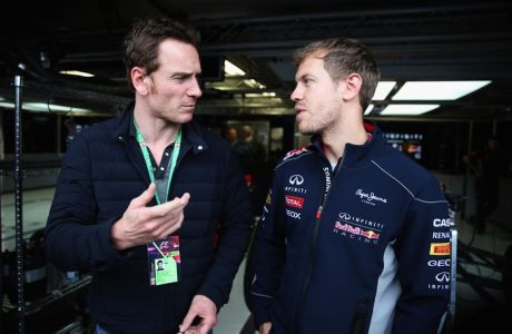 MONTREAL, QC - JUNE 08:  Actor Michael Fassbender talks with Sebastian Vettel of Germany and Infiniti Red Bull Racing following the qualifying session for the Canadian Formula One Grand Prix at the Circuit Gilles Villeneuve on June 8, 2013 in Montreal, Canada.  (Photo by Mark Thompson/Getty Images) *** Local Caption *** Sebastian Vettel; Michael Fassbender